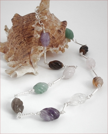 Carved quartz with silver links necklace